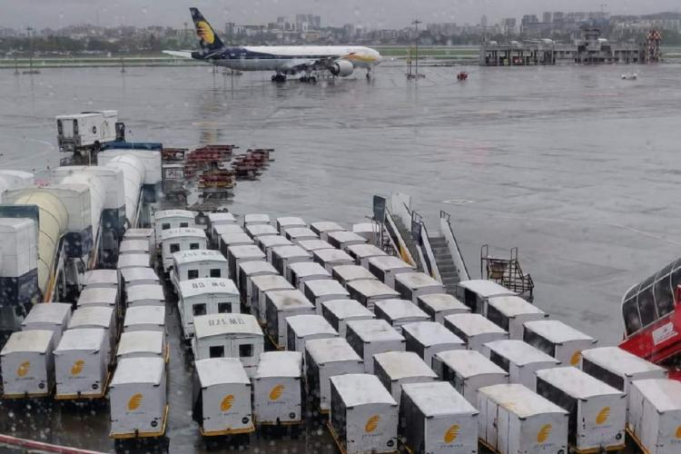 Grounded aircraft and luggage trolleys of Jet Airways in the Mumbai International airport in 2019