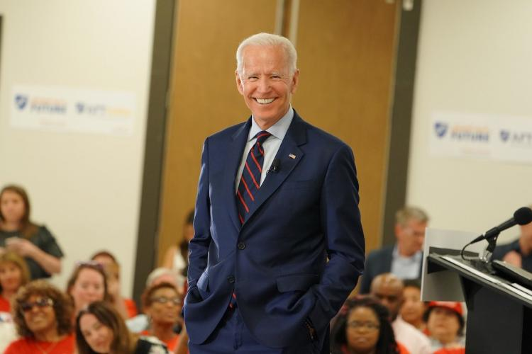 United States President Elect Joe Biden smiling and looking into camera