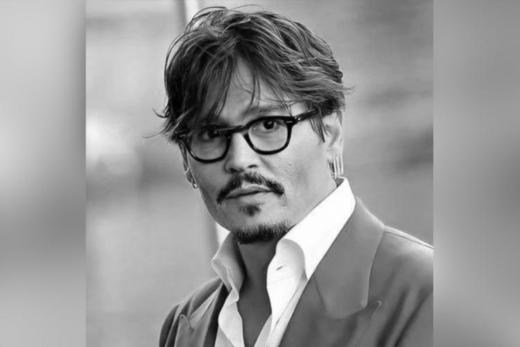 Johnny Depp wearing spectacles a black and white photo