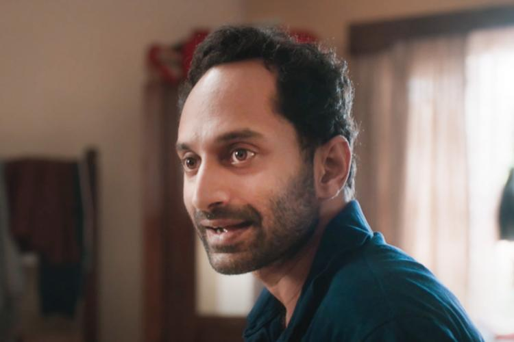 Fahadh Faasil with green shirt in Joji screenshot