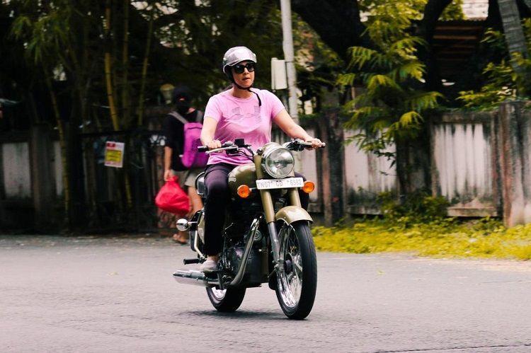 Aww moments Actor Suriya teaches wife Jothika to ride a bullet