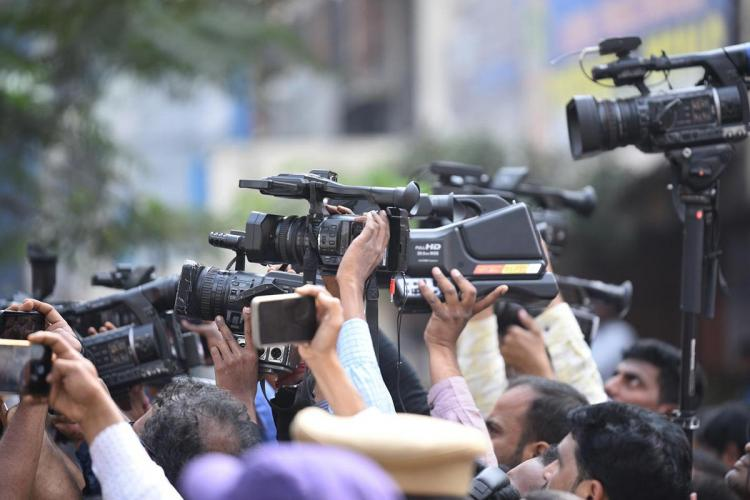 A group of mediapersons holding up cameras