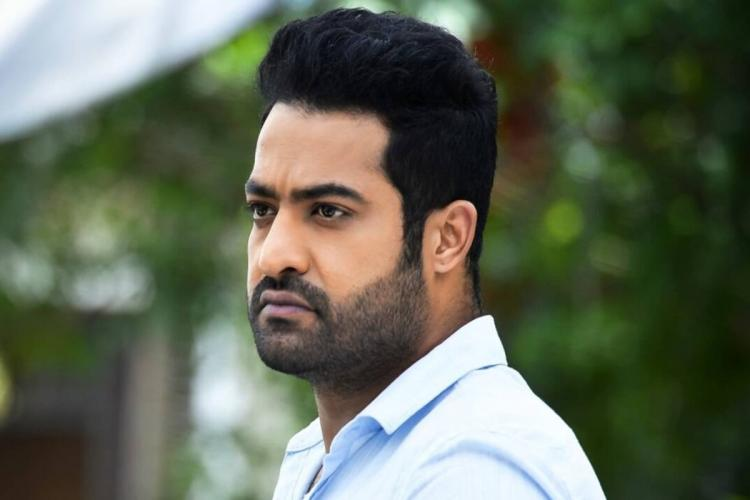 Jr NTR is seen donning a blue shirt and the actors side profile has been captured in the image