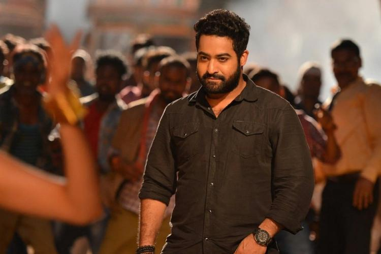 Jr NTR is seen wearing a black shirt in the image