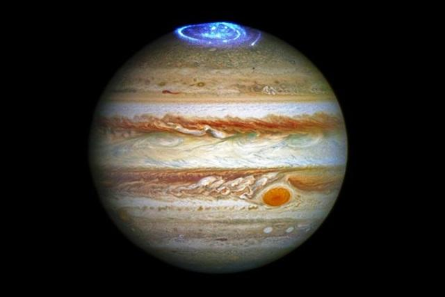 from neptune s blue hue to jupiter s red spot are the colours of