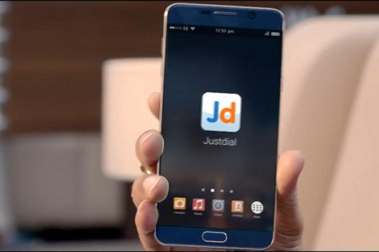 JustDial app held up on a phone