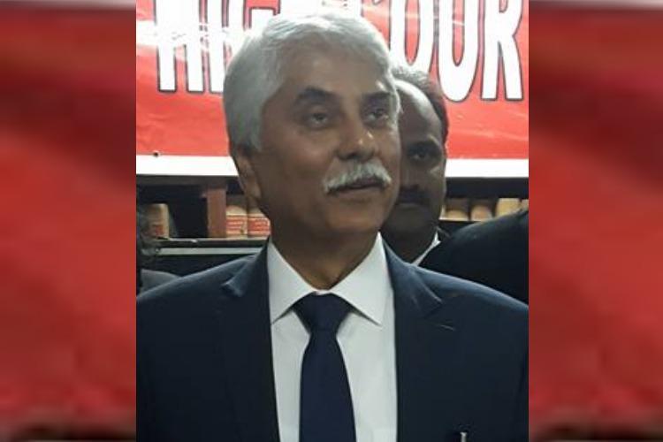 Seen on stage at BJP event former Madras HC judge Jaichandren denies joining party