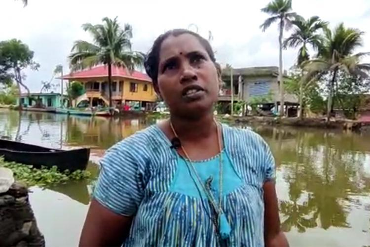 Jyothi a native of Kuttanad who lost her house in flood against the backdrop of backwaters.