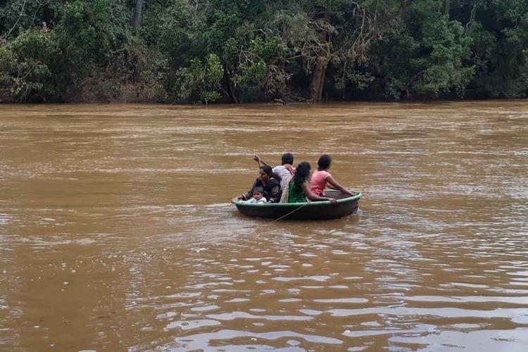 With no bridge or road these Ktaka villagers travel in coracle to cross river each day