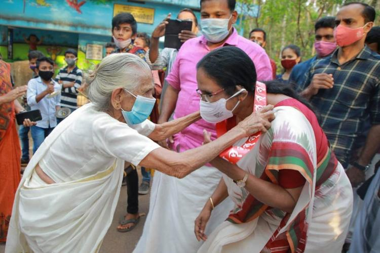 A file image of KK Shailaja being garlanded by an old woman