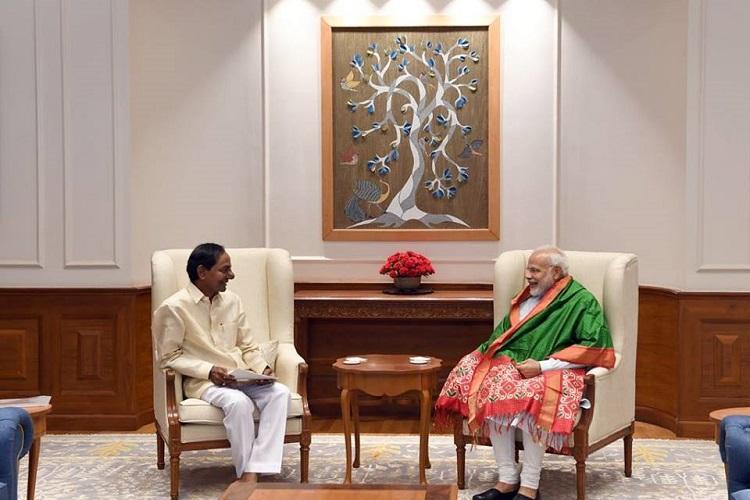 Raise Telanganas annual borrowing limit CM KCR urges PM Modi