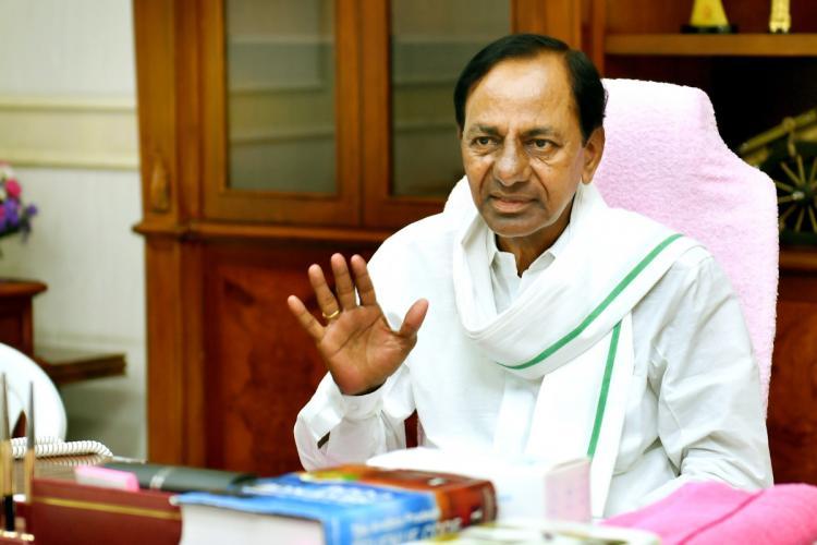 Telangana Chief Minister KCR seated at his desk