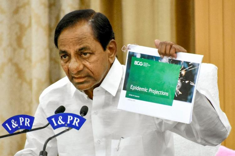 KCR, Telangana Chief Minister showing a report to the others and speaking in a mike
