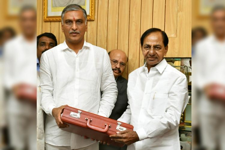 CM KCR and Harish Rao posing with the briefcase of budget documents