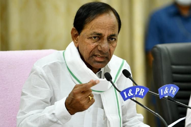 Telangana CM KCR addressing a Pressmeet sitting in a chair infront of a mike