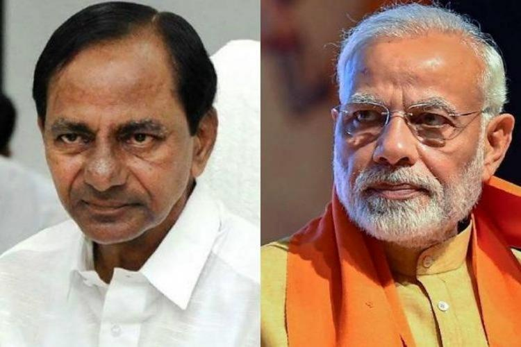 Telangana Chief Minister K Chandrasekhar Rao in a white dress and PM Narendra Modi in a orange and green dress are seen posing for a picture