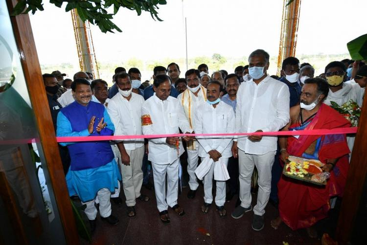 KCR and other local leaders wearing white coloured clothes and are attending a ribbon cutting ceremony