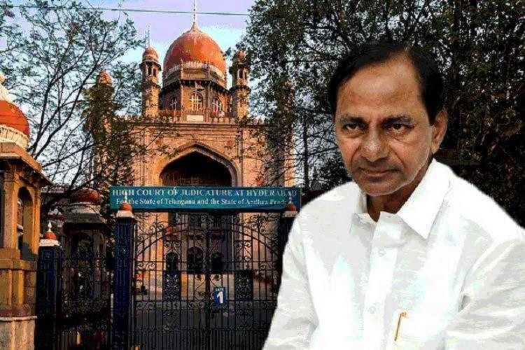 Telangana High Court is seen in the background upon which Telangana CM KCRs photo has been placed