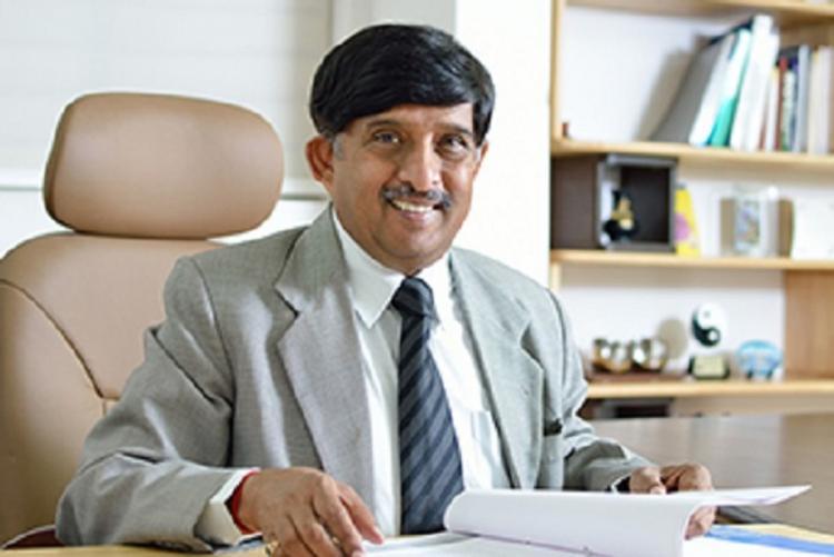 KC Ramaurthy sitting on a chair