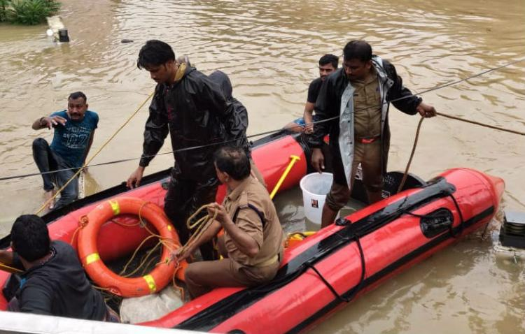 Kerala Floods: Brave Official Saves Child Minutes Before Bridge is Submerged