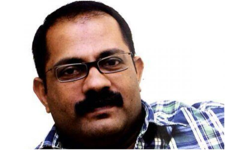 KM Shaji IUML legislator in a blue check shirt