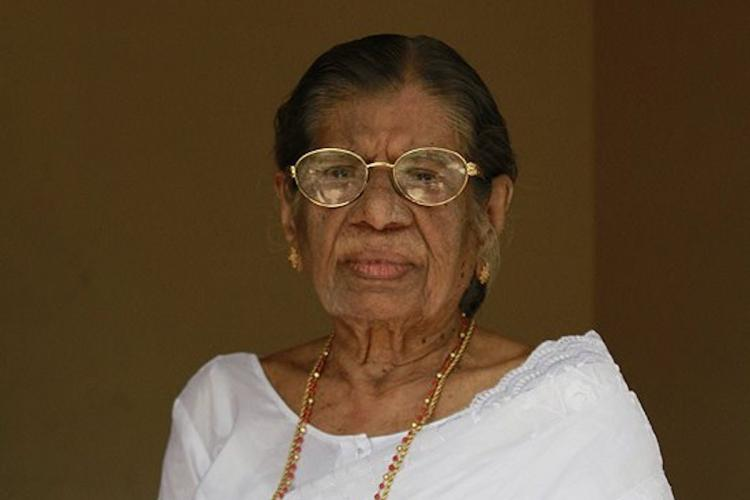 KR Gowri Amma in a white saree and spectacles