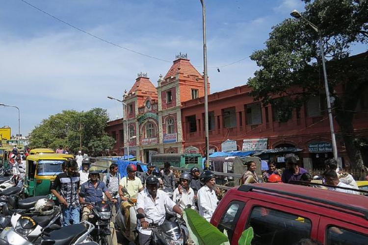 traffic and crowds outside the KR Market building in Bengaluru