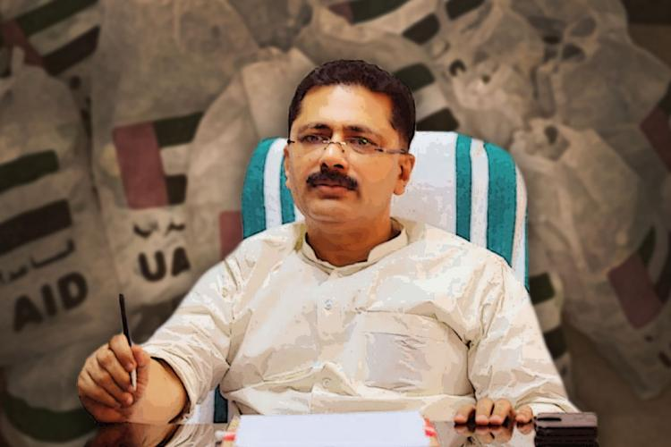 Kerala Minister KT Jaleel sitting in an arm chair
