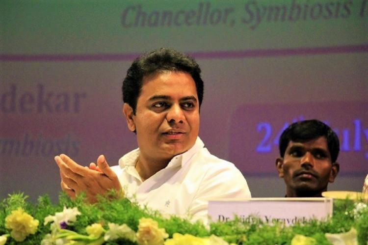 Telangana minister KTR talking to a person in a meeting