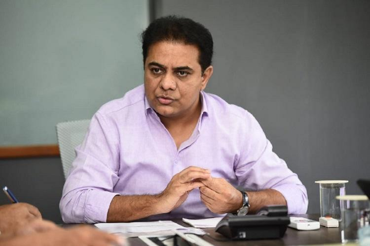 A file photo of KTR during a meeting with officials sitting behind a table
