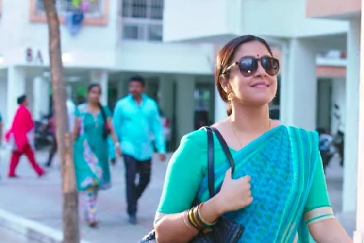 Watch Simbu compliments Jyothikas sultry hello in Kaatrin Mozhi trailer