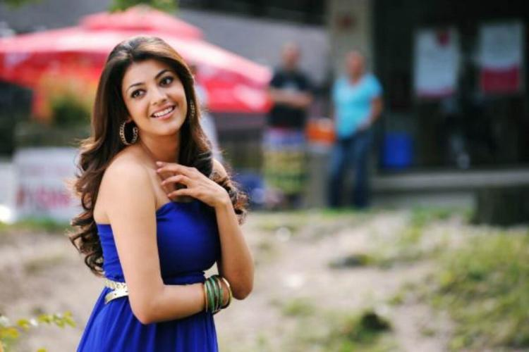 kajal in a blue dress and is seen smiling
