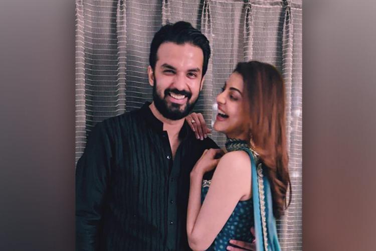Kajal Agarwal looking at Gautam Kitchlu and smiling