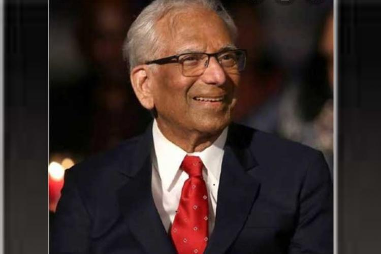 Kakarla Subbarao in a black suit smiling for the picture