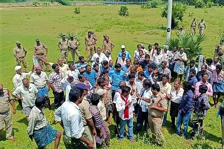 Kakinada SEZ Angry Andhra farmers attempt to reclaim land police foil protest