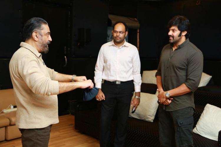 Kamal and Arya discussing about a film