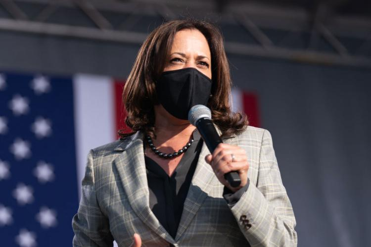 File photo of Kamala Harris speaking at an event while wearing a mask
