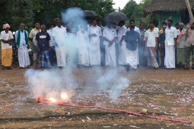 Locals of Thulasenthirapuram celebrating Kamalas victory by setting off fireworks