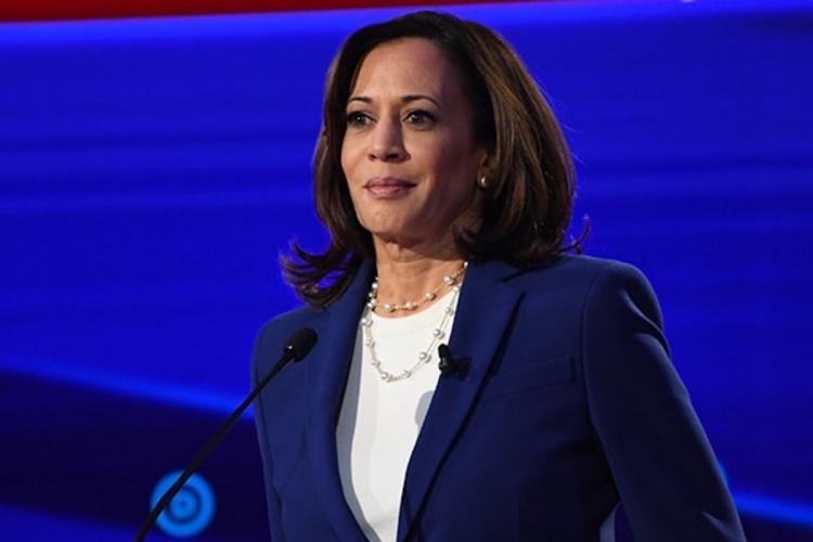Harris suspends travel after Biden campaign finds third virus link