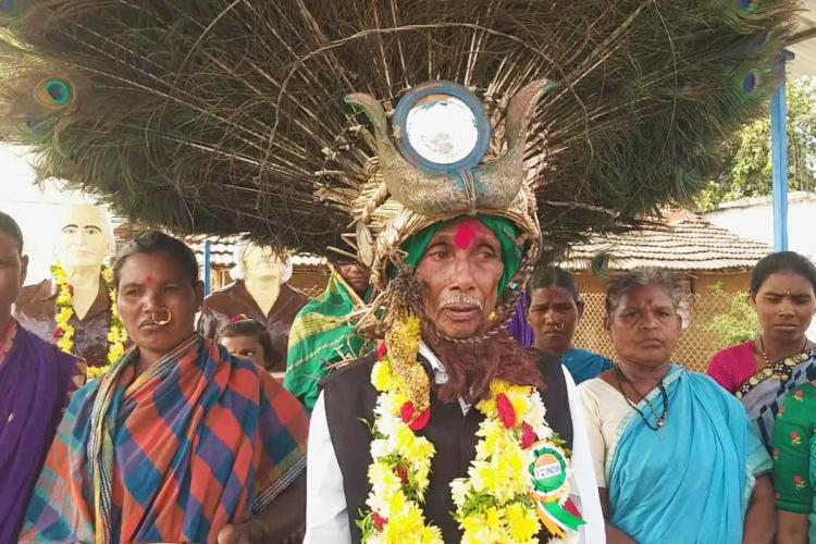 Kanaka Raju wearing the head gear