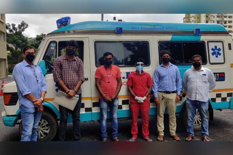 Six residents of Bengalurus Kanakapura pose near the exclusive ambulance they have hired for the next six months