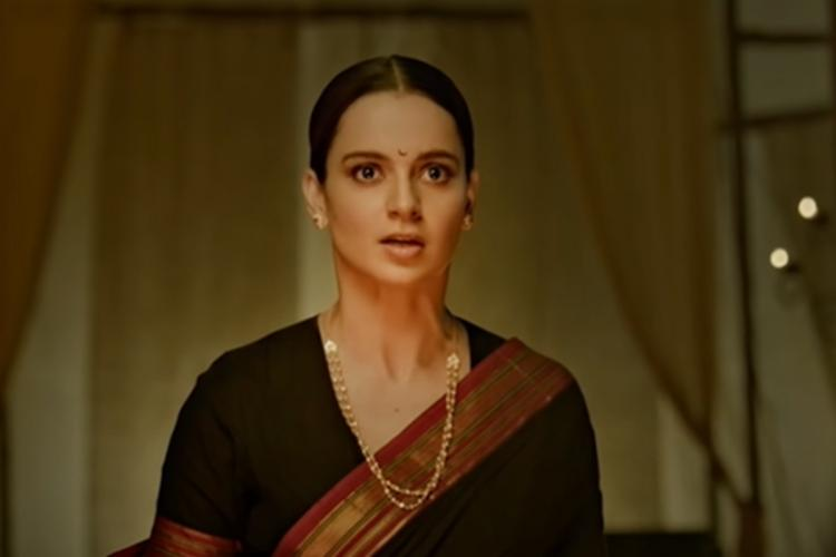Kangana Ranaut wearing a saree a screengrab from one of her movies