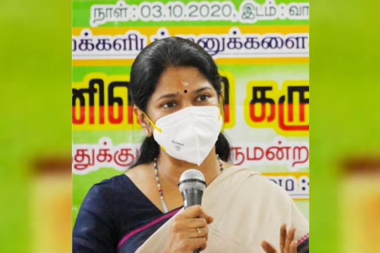 MP Kanimozhi speaks with mic in hand