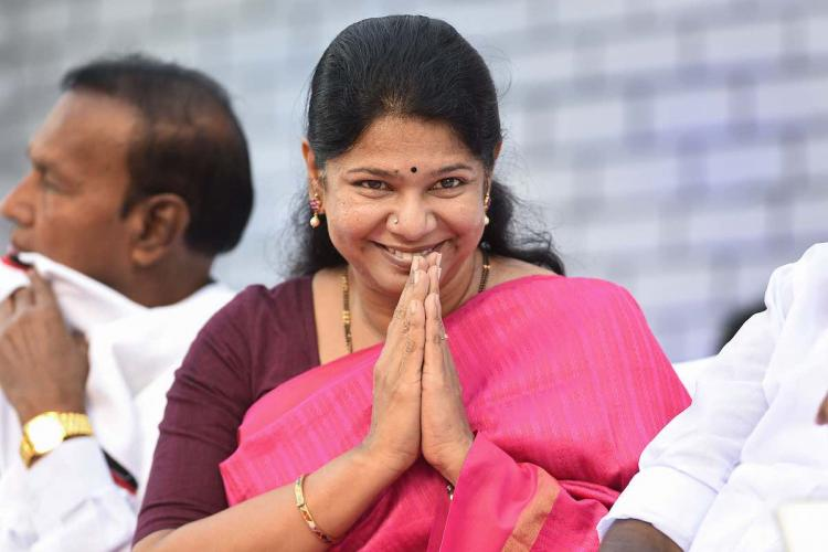 DMK leader Kanimozhi in pink saree greets with a smile during a thanksgiving meet for the party allies on Karunanidhis 96th birth anniversary in Chennai 2019
