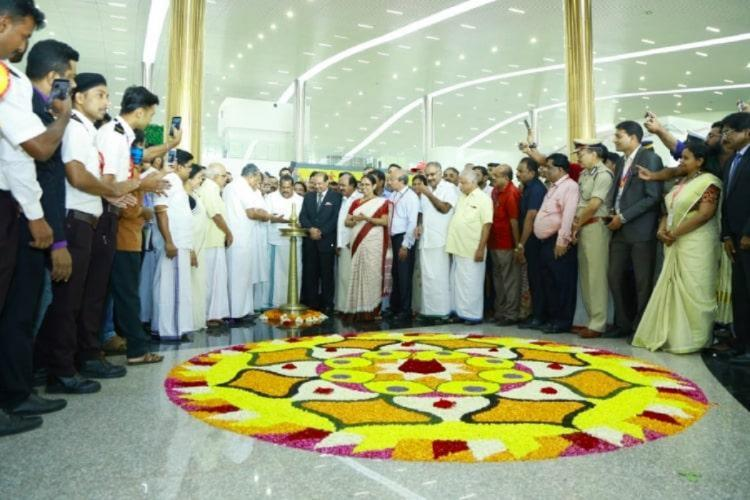 Kerala Chief Minister Pinarayi Vijayan inaugurating Kannur International airport in the presence of officials and other ministers.