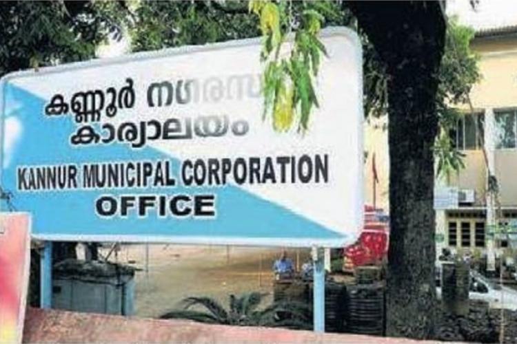 A blue and white board outside Kannur municipal corporation