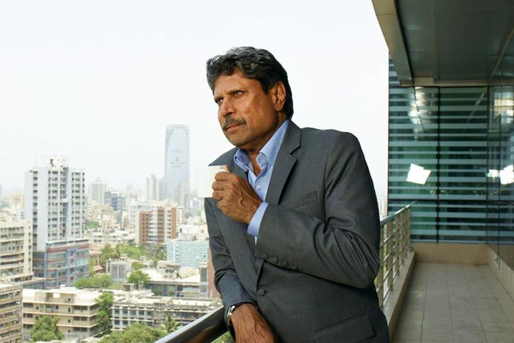 Kapil Dev standing in a balcony