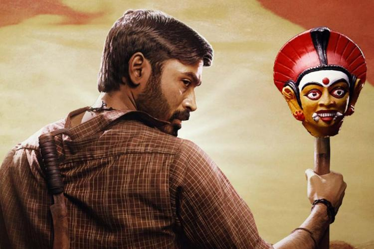 Dhanush as Karnan standing with a mask and with his back to the camera