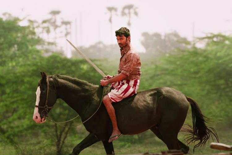 Dhanush on black horse and with sword in Karnan still
