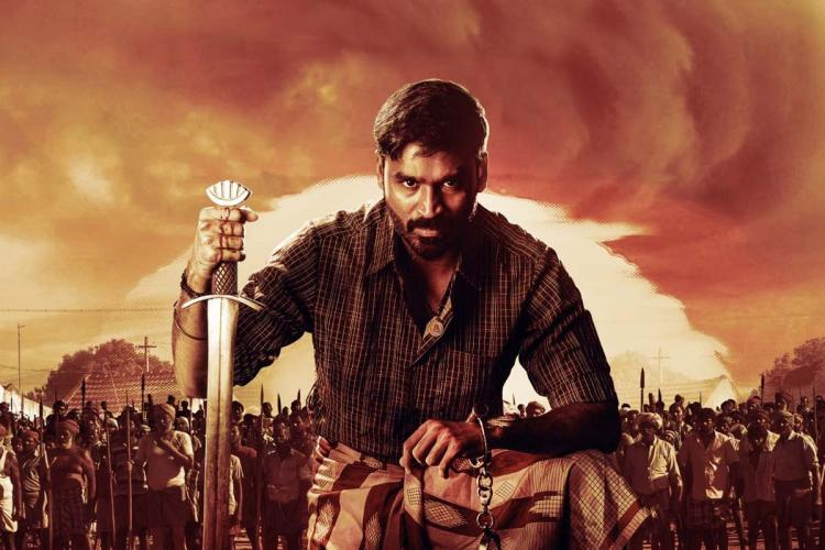 Dhanush with a sword and the sun in the background in Karnan